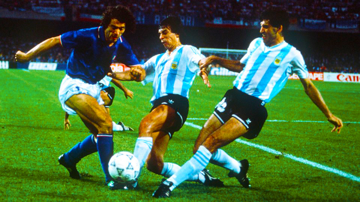 1990-World-Cup-Semi-Final-Naples-Italy-Roberto-Donadoni-is-challenged-for-the-ball-by-Argentinas-Juan-Ernesto-Simon-and-Jose-Basualdo-Photo-by-Bob-ThomasGetty-Images
